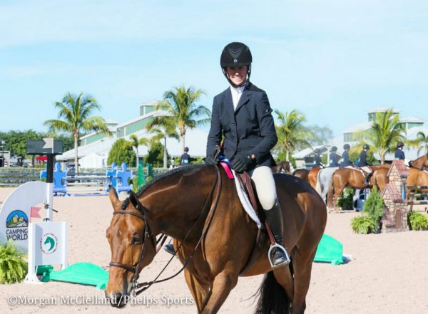 © Morgan McClelland: Mckayla Langmeier is All Amiles as she leaves the ring with a Blue ribbon