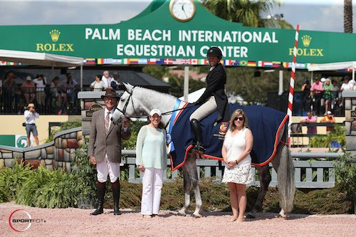 © Sportfot: Winter Stroll and Nancy Hooker in their winning presentation with  ringmaster Steve Rector, Carol Cone, and Marla Holt of the USHJA.